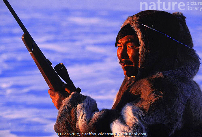 Inuit hunter in Caribou / Reindeer skin clothes, Canada. Model released.  ,  GUN,HUNTING FOOD,LANDSCAPES,MAN,NORTH AMERICA,PEOPLE,TRADITIONAL,TRIBES,Catalogue1  ,  Staffan Widstrand