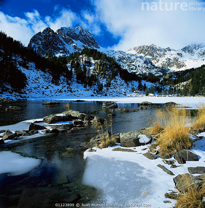 Partly frozen lake below Aigues Tortes i Estany Sant Maurici NP, The Pyrenees, Lerida, Catalonia, Spain. Europe  ,  ALPINE,COLD,EUROPE,HIGHLANDS,ICE,LAKES,LANDSCAPES,MOUNTAINS,NP,RESERVE,SNOW,SPAIN,WATER,WINTER,National Park  ,  Juan Manuel Borrero