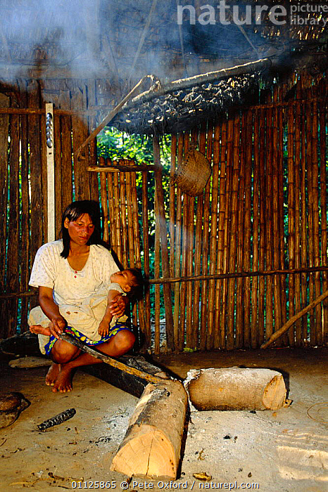 Machiguenga Indian at cooking fire, Timpia Community, Peru, Amazonia Lower Urubamba  ,  BABY,BUILDINGS,HUT,LANDSCAPES,MOTHER,PEOPLE,RIVER,TRADITIONAL,TRIBES,TROPICAL RAINFOREST,VERTICAL,SOUTH-AMERICA  ,  Pete Oxford