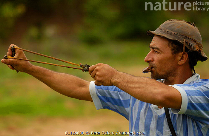 Bird hunting with whistle to call Doves + sling shot, Caatinga, Bahia state, Brazil  ,  BIRDS,BRAZILIAN,CATAPULT,FARMER,HUNTING FOOD,LANDSCAPES,MAN,PEOPLE,TRADITIONAL,SOUTH-AMERICA  ,  Pete Oxford