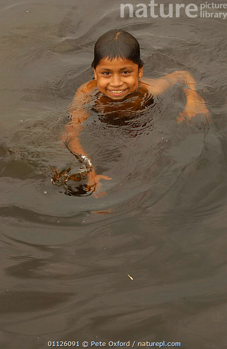 Quechua indian child swimming, A�angu Community, Yasuni NP, Napo River, Ecuador  ,  CHILDREN,LANDSCAPES,PEOPLE,RIVERS,THREE,TRADITIONAL,TRIBES,TROPICAL RAINFOREST,VERTICAL  ,  Pete Oxford