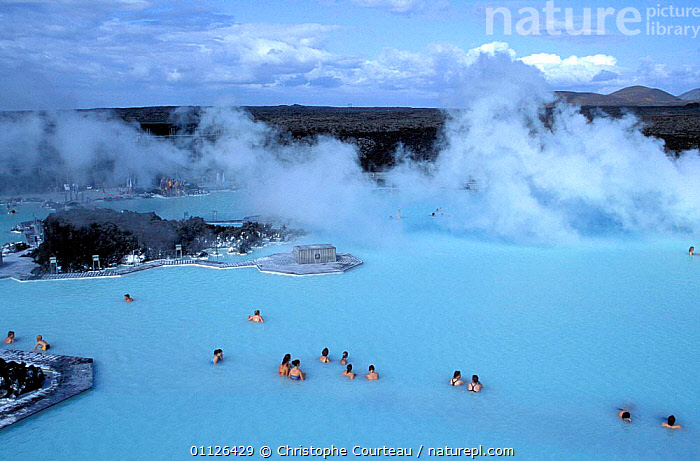 Tourists bathing in Blue Lagoon 42 degrees C, Krisuvik, Iceland  ,  ALGAE,CYANOBACTERIA,GEOTHERMAL,HOT SPRINGS,LANDSCAPES,MINERALS,PEOPLE,STEAM,TOURISM,WATERS,Geology,Plants,Europe  ,  Christophe Courteau