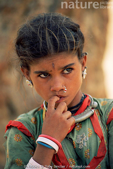 Young Rajasthani woman portrait, Jhalor, Rajasthan, India  ,  LANDSCAPES,PORTRAITS,PEOPLE,ASIA,ASIAN,VERTICAL,INDIAN-SUBCONTINENT,INDIA  ,  Toby Sinclair