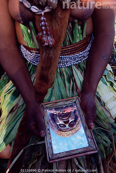 Woman looking at face in mirror #NAME? show, Papua New Guinea, 2001  ,  VERTICAL,REFLECTIONS,TRIBES,LANDSCAPES,PEOPLE,PAPUA NEW GUINEA,WEST-AFRICA  ,  Patricio Robles Gil