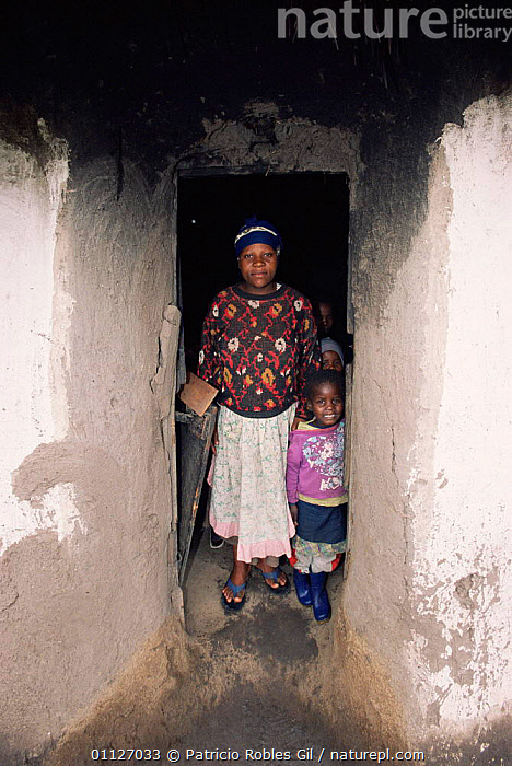 Mother and child in doorway, Eastern Cape, South Africa, 2003  ,  SOUTHERN AFRICA,VERTICAL,VILLAGES,BUILDINGS,PEOPLE,LANDSCAPES  ,  Patricio Robles Gil