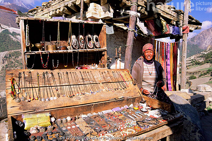 Woman selling jewellry and local crafts, Manang district, Nepal, PEOPLE,LANDSCAPES,TRADE,HIMALAYAS,ASIA,INDIAN-SUBCONTINENT, Andrew Parkinson
