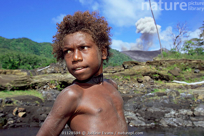 Local boy collecting water, Mount Yasur erupting in background, Tanna, Vanuatu  ,  PEOPLE,MT,LANDSCAPES,CHILDREN,VOLCANOES,WORKING,TRADITIONAL,TRIBES,Geology,MELANESIA  ,  Justine Evans