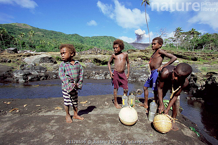 Local boys collecting water, Mountt Yasur erupting in background, Tanna, Vanuatu, South Pacific  ,  PEOPLE,MT,LANDSCAPES,BOY,CHILDREN,VOLCANOES,WORKING,TRADITIONAL,TRIBES,Geology,MELANESIA  ,  Justine Evans