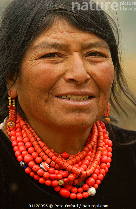 A Salasaca Indian woman wearing traditional red glass beads, Andes, Ecuador  ,  PEOPLE,LANDSCAPES,JEWELLRY,FACES,PORTRAITS,TRIBES,VERTICAL  ,  Pete Oxford