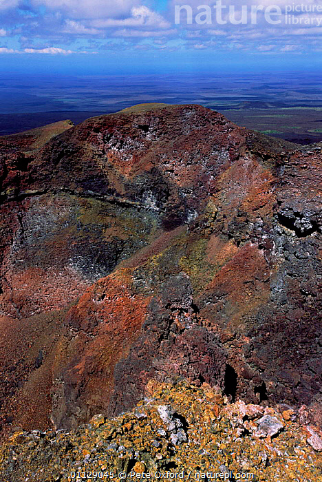 Rocks on rim of cone of active volcano, Sierra Negra, Isabela Is, Galapagos.  ,  LANDSCAPES,VOLCANOES,VERTICAL,ROCK FORMATIONS,LAVA,Geology,SOUTH-AMERICA  ,  Pete Oxford