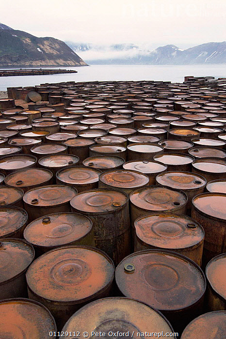 Rusting barrels, relics of submarine base, Shimushir Is, Kuril Is, Kamchatka, E Russia  ,  ASIA,COASTS,ENERGY,LANDSCAPES,RUST,VERTICAL,OIL,POLLUTION,CIS  ,  Pete Oxford