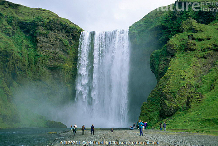 Tourists at Skogafoss waterfall, Iceland  ,  TOURISM,SIZE,LARGE,LANDSCAPES,PEOPLE,WATERFALLS,Europe  ,  Michael Hutchinson