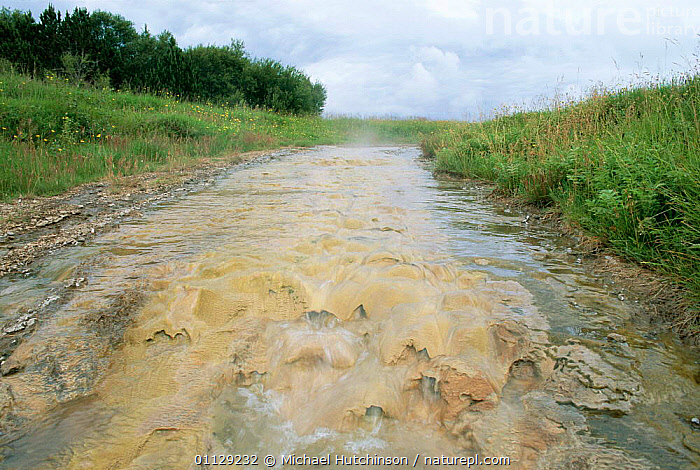 Mineral deposits on bed of stream fed by geysers, Geysir, Iceland  ,  MINERALS,LANDSCAPES,STREAMS,RIVERS,GEOTHERMAL,FRESHWATER,Geology,Europe  ,  Michael Hutchinson