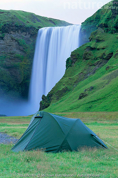 Campers at Skogafoss waterfall, Iceland, WATERFALLS,TENT,TOURISM,LANDSCAPES,VERTICAL,TOURISTS,TENTS,CAMPING,Europe, Michael Hutchinson