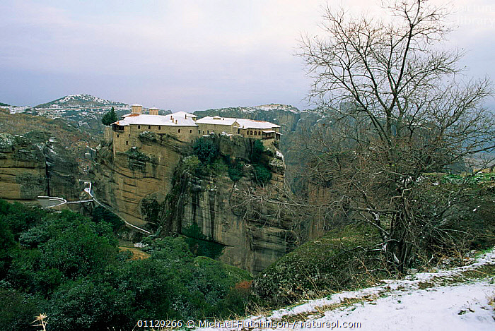 Monastery perched on sandstone rock tower, Meteora, Greece  ,  BUILDINGS,CLIFFS,LANDSCAPES,SNOW,WINTER,VERTICAL,Geology,Europe  ,  Michael Hutchinson