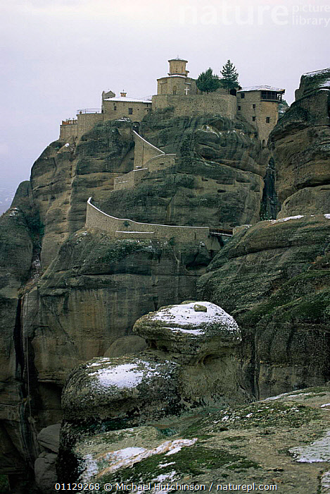 Path up to monastery perched on sandstone rock tower, Meteora, Greece  ,  BUILDINGS,CLIFFS,LANDSCAPES,SNOW,VERTICAL,ROADS,WINTER,Geology,Europe  ,  Michael Hutchinson