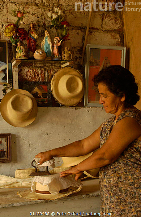 Eva Mero ironing Panama hats, Montecristi, Ecuador 2004  ,  HAT,LANDSCAPES,MAKING,PEOPLE,TRADITIONAL,VERTICAL  ,  Pete Oxford