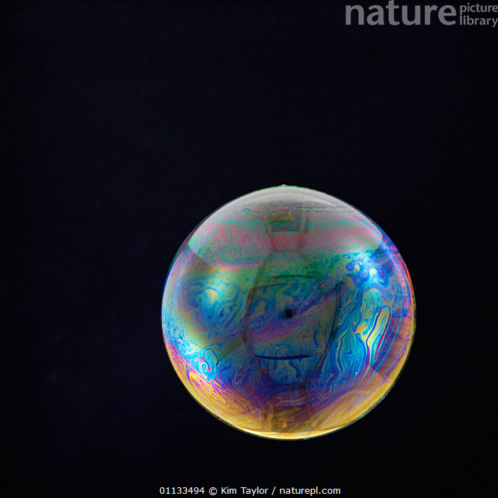 A soap bubble floating in the air - colour refraction on surface  ,  LIGHT,IRIDESCENCE,WATER,CIRCLES,COLOURS,CUTOUT,BUBBLES,HANGING  ,  Kim Taylor
