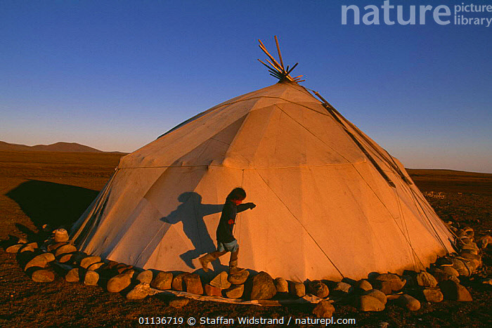 Chukchi girl playing beside her family's Yaranga tent, Chukotka, Russia  ,  CAMPING,ASIA,PEOPLE,NOMADIC,CHILDREN,TRADITIONAL,TRIBES,SHADOWS,HOMES,FAMILY,TENTS,CIS,Catalogue1  ,  Staffan Widstrand