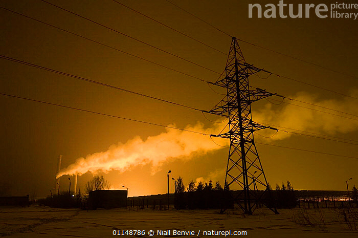 Steam from heating plant with electricity pylon, Estonia.  ,  ENERGY,ESTONIA,INDUSTRY,NIGHT,POLLUTION,POWER  ,  Niall Benvie