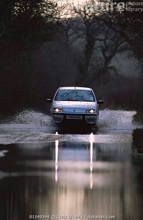 Car driving through flood on country road, Derbyshire, UK  ,  EUROPE,FLOODING,FLOODS,GLOBAL WARMING,ROADS,UK,VEHICLES,VERTICAL,WEATHER,United Kingdom,British,ENGLAND  ,  Chris O'Reilly