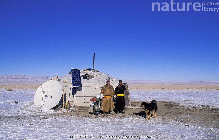 Nomadic tribal people outside their traditional yurt with modern satellite dish and solar panels, Gobi Desert, Mongolia, January 2004. Filmed for BBC Planet Earth series.  ,  ASIA,CULTURES,DESERTS,DOGS,GOBI,HOMES,MODERN,MOTORBIKE,NOMADIC,PEOPLE,PLANET EARTH,SNOW,TENTS,TRADITIONAL,TRIBAL,TRIBES,VEHICLES,YURT  ,  Huw Cordey