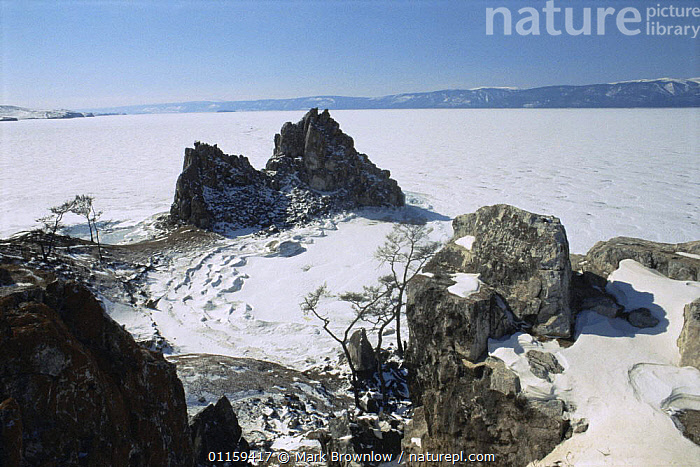 Looking down on frozen surface of Lake Baikal, world's deepest and oldest (and largest by volume) freshwater lake, Siberia, Russia. BBC Planet Earth series, April 2005  ,  AERIALS,COLD,FROZEN,ICE,ISLANDS,LAKES,LANDSCAPES,ROCKS,RUSSIA,SHORELINE,SNOW,CIS  ,  Mark Brownlow