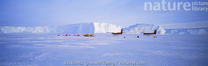 Tented camp on ice with aeroplanes, near to Emperor Penguin (Aptenodytes forsteri) colony, Dawson-Lambton Glacier, Weddell Sea, Antarctica. November  ,  ANTARCTICA,CAMPING,EXPEDITION,GLACIERS,ICE,LANDSCAPES,PANORAMIC,PENGUINS,PEOPLE,POLAR,RESEARCH,SNOW,TENTS,VEHICLES,Geology  ,  David Tipling