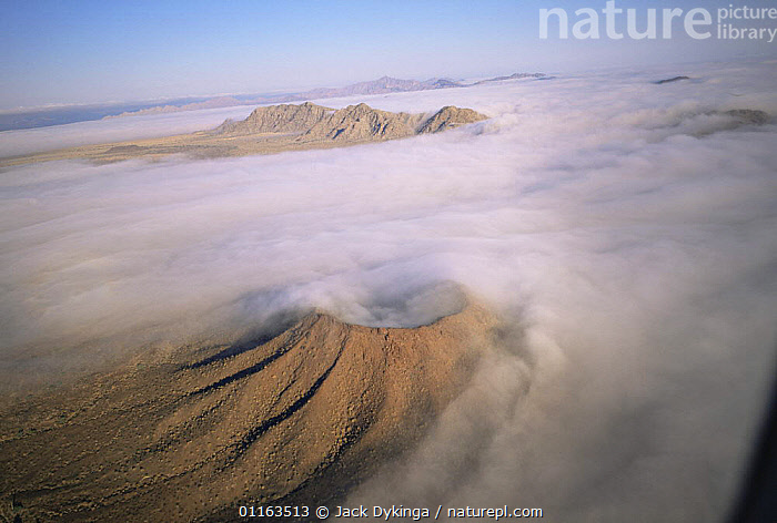 Aerial view of ground fog swirling round Crater Caravajales, Biosphere Reserve of Pinacate and Gran Desierto Altar, Sonora, Mexico  ,  AERIALS,CENTRAL AMERICA,DESERTS,LANDSCAPES,MEXICO,MIST,RESERVE,VOLCANOES,WEATHER,Geology,CENTRAL-AMERICA  ,  Jack Dykinga