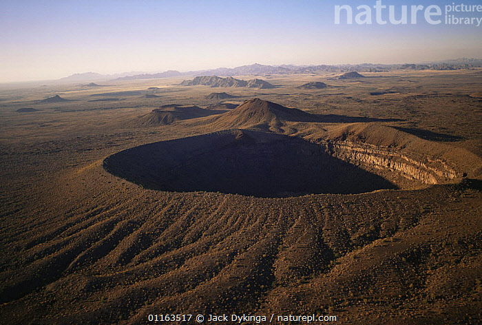 Aerial view of Sykes crater with MacDougal crater and Sierra Hornaday in the background, Biosphere reserve of Pinacate and Gran Desierto Altar, Sonora, Mexico  ,  AERIALS,CENTRAL AMERICA,CINDER CONE,DESERTS,LANDSCAPES,MEXICO,MOUNTAINS,RESERVE,VOLCANOES,Geology,CENTRAL-AMERICA  ,  Jack Dykinga