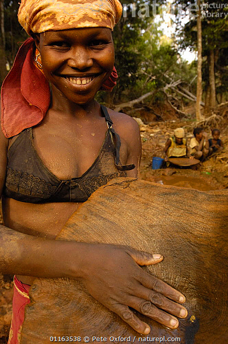 Woman panning for gold and showing a gold nugget. This mining is now illegal as it takes place in the protected forest of Daraina which is the habitat for the Golden-crowned / Tattersall's sifaka (Propithecus tattersalli) in North-east MADAGASCAR