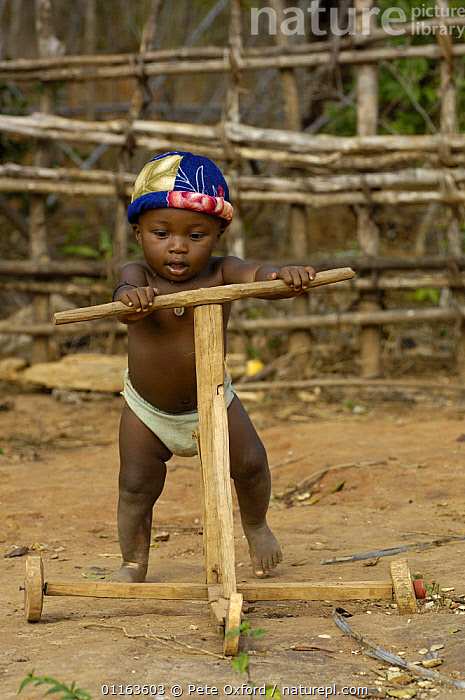 Young child learning to use a home-made walker, Daraina, northern Madagascar 2005  ,  CHILD,Home made,MADAGASCAR,MOTHER,PEOPLE,toys,babies,toddler  ,  Pete Oxford