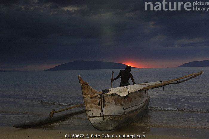 Fisherman returns from night fishing in Piroque or outrigger canoe, Ampasendava Village. North eastern MADAGASCAR 2005  ,  BOATS,COASTS,FISH,Fishing,MADAGASCAR,PEOPLE,TRADITIONAL  ,  Pete Oxford