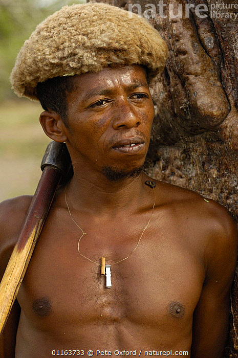 Antandroy man wearing hat made from goat skin. MADAGASCAR 2005  ,  MADAGASCAR,PEOPLE,PORTRAITS,TRADITIONAL,TRIBES,VERTICAL  ,  Pete Oxford