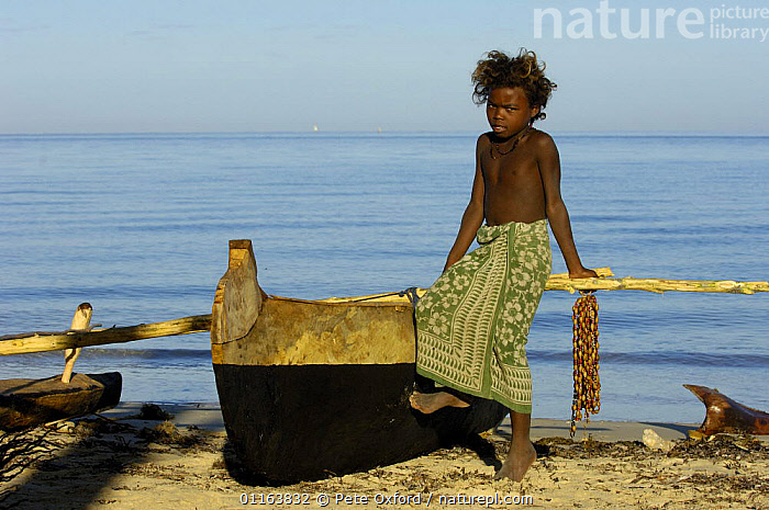 Child selling necklaces on the beach made from seeds and shells found locally. Mangily, near Ifaty. South-western MADAGASCAR  ,  CHILDREN,COASTS,MADAGASCAR,SEEDS,shells,TRADE,TRADITIONAL  ,  Pete Oxford