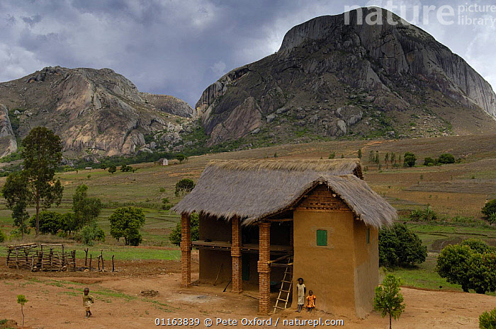 Local brick and thatched house belonging to people of the Bara tribe, with granite rocks in the background. Near Andringitra mountains, MADAGASCAR   2005  ,  Bara,brick,ethnic,house,LANDSCAPES,MADAGASCAR,PEOPLE,TRADITIONAL,TRIBES  ,  Pete Oxford