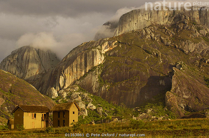 Betsileo house near Ambalavao town. South-central highlands of MADAGASCAR. Granite cliffs in background  ,  BUILDINGS,LANDSCAPES,MADAGASCAR,RESERVE,TRADITIONAL  ,  Pete Oxford