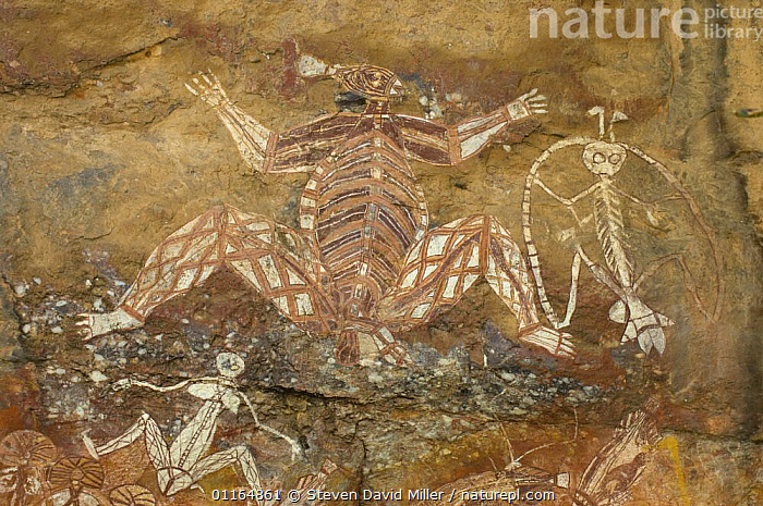 Rock art, Kakadu National Park, Northern Territory, Australia - The central figure is Namondjok, a dangerous spirit; to the right is Namarrgon the lightening man, on the bottom left is Barrginj, Namarrgon's wife; the art panel was painted by Nayombolmi (Barramundi Charlie).  ,  ART,AUSTRALASIA,AUSTRALIA,ROCKS  ,  Steven David Miller