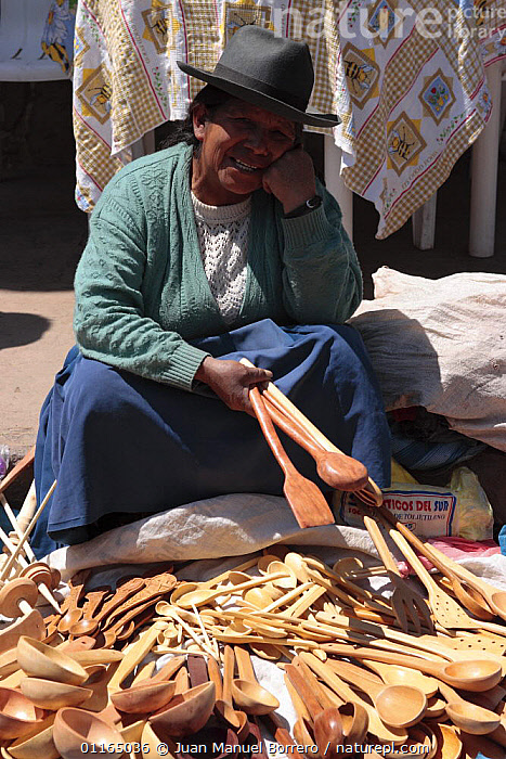 Indian woman selling wooden spoons in market, Pisac, Sacred Valley, Peru 2006.  ,  ANDES,PEOPLE,SOUTH AMERICA,TRADE,VERTICAL,SOUTH-AMERICA  ,  Juan Manuel Borrero