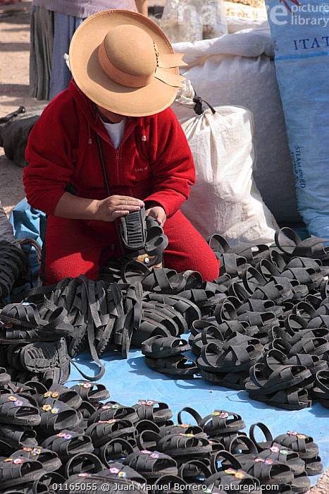 Indian woman wearing hat, selling sandals at  market, Chinchero, Sacred Valley, Peru 2006., ANDES,PEOPLE,SOUTH AMERICA,TRADE,VERTICAL,SOUTH-AMERICA, Juan Manuel Borrero