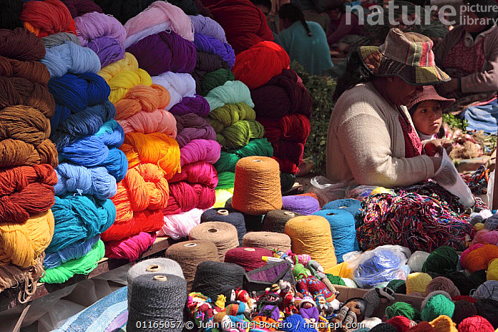 Indian woman and girl selling variety of wool colours, Chinchero, Sacred Valley, Peru 2006.  ,  ANDES,CENTRAL AMERICA,COLOURFUL,PEOPLE,SOUTH AMERICA,TRADE,SOUTH-AMERICA  ,  Juan Manuel Borrero