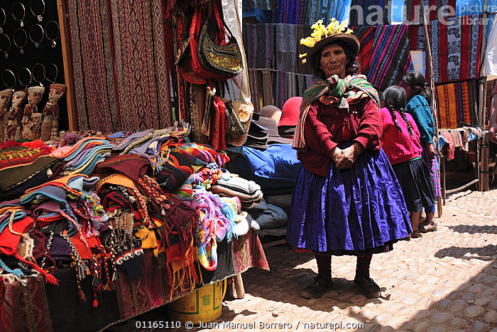 Indian woman in traditional clothing by hat stall, market of Pisac, Sacred Valley, Peru 2006., ANDES,COLOURFUL,MARKETS,PEOPLE,SOUTH AMERICA,TOWNS,TRADE,TRADITIONAL,TRIBES,SOUTH-AMERICA, Juan Manuel Borrero