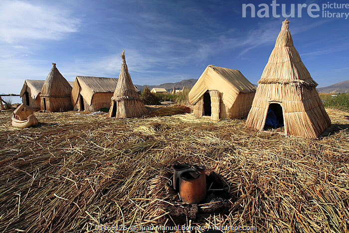 Huts on Uros Floating reed Islands, Lake Titicaca, Peru 2006.  ,  ANDES,CULTURES,HOMES,LAKES,SOUTH AMERICA,TRADITIONAL,TRIBES,SOUTH-AMERICA  ,  Juan Manuel Borrero