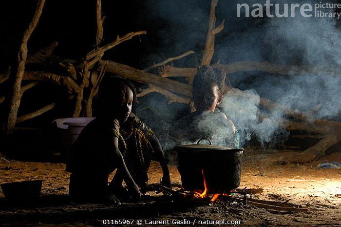 Fulani children cooking at night while their parents are busy with the cattle, North Senegal, West Africa, 2005  ,  FIRE,FOOD,PEOPLE,TRIBES,WEST AFRICA,Africa,WEST-AFRICA,Catalogue1F  ,  Laurent Geslin