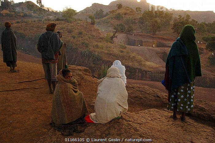 Worshippers praying at dawn outside St George's Church, Lalibela, North Ethiopia, St George's church is carved from a single block of rock, 2006  ,  CHRISTIAN,EAST AFRICA,GROUPS,PEOPLE,RELIGION,Africa,EAST-AFRICA  ,  Laurent Geslin