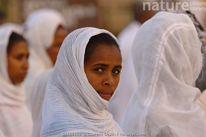 Women dressed in white during the St Marie celebration procession in the street of Gondhar, North Ethiopia, 2006  ,  CHRISTIAN,EAST AFRICA,PEOPLE,PORTRAITS,RELIGION,TRADITIONAL,WOMEN,Africa,EAST-AFRICA,Catalogue1F  ,  Laurent Geslin