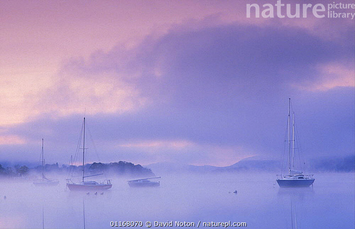 Boats on Windermere at dawn, Bowness-on-Windermere, Lake District National Park, Cumbria, England, UK  ,  ATMOSPHERIC,BOATS,CLOUDS,EUROPE,LAKES,LANDSCAPES,MIST,MISTY,SILHOUETTES,SUNRISE,UK,WATER,United Kingdom,Weather,British,ENGLAND, United Kingdom, United Kingdom, United Kingdom  ,  David Noton