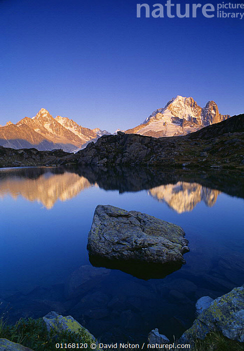 The Dru and Arguille de Argentiere reflected in the Lac des Cheserys, Massif du Mont Blanc, nr Chamonix, Savoie, France  ,  EUROPE,LAKES,LANDSCAPES,MOUNTAINS,PEACEFUL,PEAKS,REFLECTIONS,ROCKS,TRAVEL,VERTICAL,WATER,Concepts  ,  David Noton