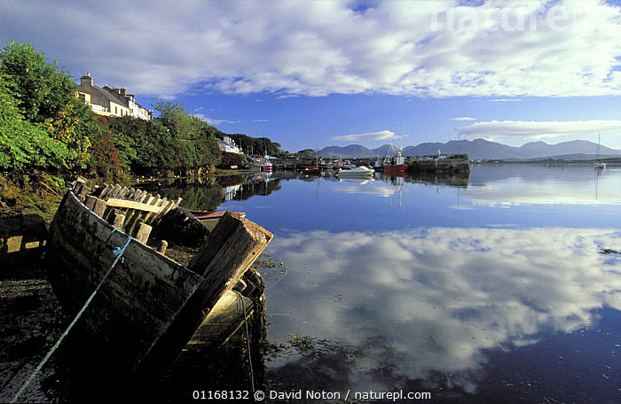 Roundstone, Connemara, Co Galway, Ireland  ,  BOATS,BUILDINGS,CLOUDS,COASTS,EUROPE,LANDSCAPES,REFLECTIONS,VILLAGES,WATER,Weather,IRELAND (SOUTHERN)  ,  David Noton