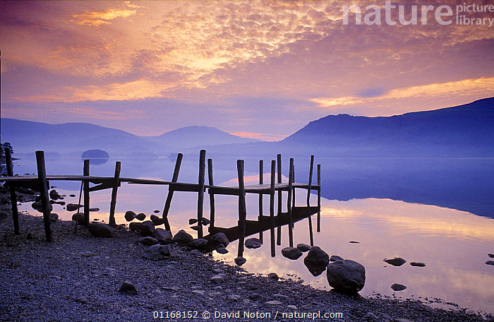 Landing Jetty on shore of Derwentwater at dawn, Lake District National Park, Cumbria, England, UK  ,  CLOUDS,DAWN,EUROPE,HILLS,LAKES,LANDSCAPES,PEACEFUL,REFLECTIONS,ROCKS,SUNRISE,UK,WATER,United Kingdom,Concepts,Weather,British,ENGLAND, United Kingdom, United Kingdom, United Kingdom  ,  David Noton